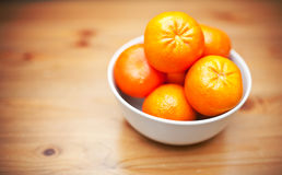 Bowl of fresh mandarins Stock Photos
