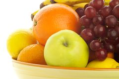 Bowl of fresh mixed fruit, backlit. Royalty Free Stock Image