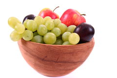 Bowl of fresh mixed fruit in wooden bowl Royalty Free Stock Image