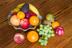 Bowl with fresh, natural looking fruit Stock Photography