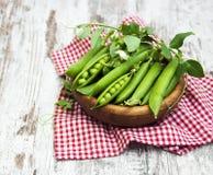 Bowl with fresh peas Stock Photos