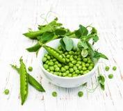 Bowl with fresh peas Stock Image