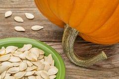 Bowl of fresh pumpkin seeds Stock Photos