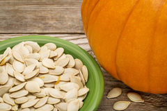 Bowl of fresh pumpkin seeds Royalty Free Stock Images