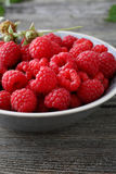 Bowl of fresh  raspberries close-up. Summer food Stock Photos