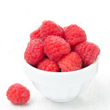 Bowl with fresh raspberries on a white background close-up. Bowl with fresh raspberries on a white background Royalty Free Stock Photography
