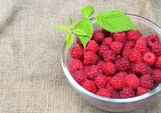 Bowl of fresh raspberry. On sacking background Royalty Free Stock Photo