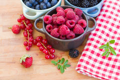 Bowl of fresh raspberry. On wooden table Stock Photography