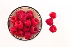 Bowl of Red Raspberries against a white background. Bowl of Fresh Red Raspberries against a white background Royalty Free Stock Photo