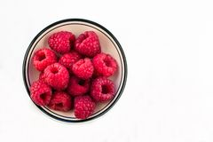 Bowl of Red Raspberries against a white background. Bowl of Fresh Red Raspberries against a white background Stock Photography