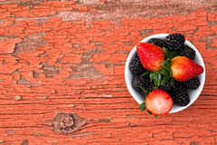 Bowl of fresh ripe mixed berries Stock Image