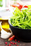 Bowl of fresh rucola Stock Images