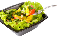 Bowl of fresh salad and fork Stock Photos
