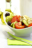 Bowl with fresh salad fork and olive oil Stock Photography