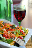 Salad and a glass of wine Stock Photography