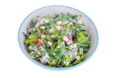 Bowl with fresh salad greens and radish. Studio Photo Stock Photo