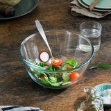 Bowl of fresh salad on rustic kitchen wooden table. Bowl of fresh salad on a rustic kitchen wooden table Stock Photos
