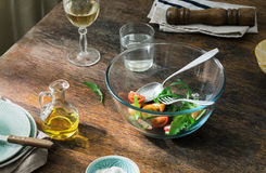Bowl of fresh salad on a rustic wooden table. With copy space Stock Photo