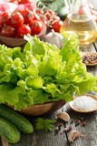 Bowl with fresh salad, vegetables, spices and olive oil Stock Photos