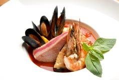 Bowl of fresh seafood soup tom yam with shrimps tuna salmon cala Stock Photo