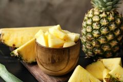 Bowl with fresh sliced pineapple. Closeup Stock Image