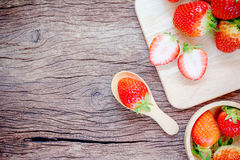 Bowl with fresh strawberries on an old wooden table. Royalty Free Stock Photography