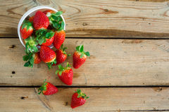 Bowl with fresh strawberries. On an old wooden table. top view royalty free stock photo