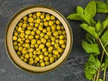 Bowl of Fresh Summer Garden Peas Stock Photo
