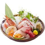 Bowl of fresh sushi with tuna, abalone, shrimp and herbs.  Royalty Free Stock Image