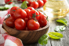 Bowl with fresh tomatoes, spinach and olive oil, close-up Royalty Free Stock Image