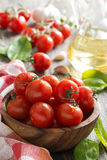 Bowl with fresh tomatoes, spinach and olive oil Royalty Free Stock Photography