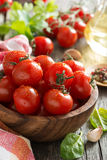 Bowl with fresh tomatoes, spinach, spices and olive oil, closeup Stock Image