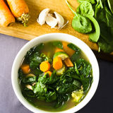 A Bowl of Fresh Vegetable Soup with Ingredients Royalty Free Stock Photos
