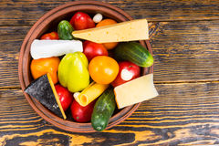 Bowl of Fresh Vegetables and Cheese on Wood Table Stock Photography