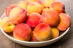 Bowl of fresh yellow peaches Stock Photo