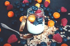 Healthy breakfast with yoghurt and berries in a jar royalty free stock photography