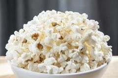 Bowl of freshly made popcorn. Side view. Delicious snack while watching movies Royalty Free Stock Photos