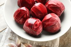 Bowl with freshly peeled beets. On table Royalty Free Stock Photo