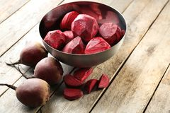 Bowl with freshly peeled beets. On table Stock Photography