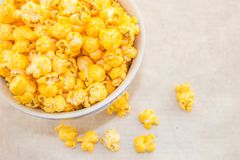 A bowl of freshly popped homemade popcorn. A bowl of freshly popped popcorn with cheese on a white background Stock Photography