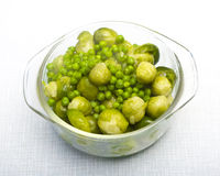 Bowl of freshly steamed peas and vegetables Royalty Free Stock Photo