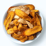 Bowl of fried carrot and parsnip chips. Isolated from above. Stock Image