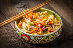 Bowl of fried chicken with vegetables. Stock Image