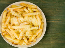 Bowl of Fried and Grilled Cheesy Chips Stock Photo
