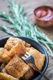 Bowl of fried ravioli on the wooden board. Bowl of fried ravioli on the wooden background Stock Photos