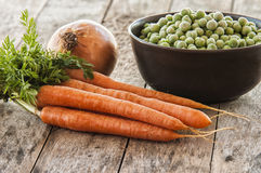 A bowl of frozen green peas with carrots Royalty Free Stock Photography