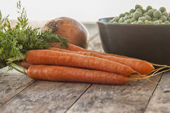 A bowl of frozen green peas with carrots Royalty Free Stock Images