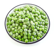 Bowl of frozen green peas Royalty Free Stock Images