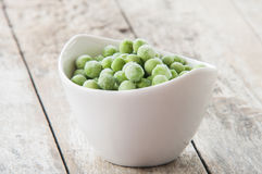 Bowl of frozen peas Royalty Free Stock Photo