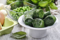 Bowl of frozen spinach Royalty Free Stock Photography